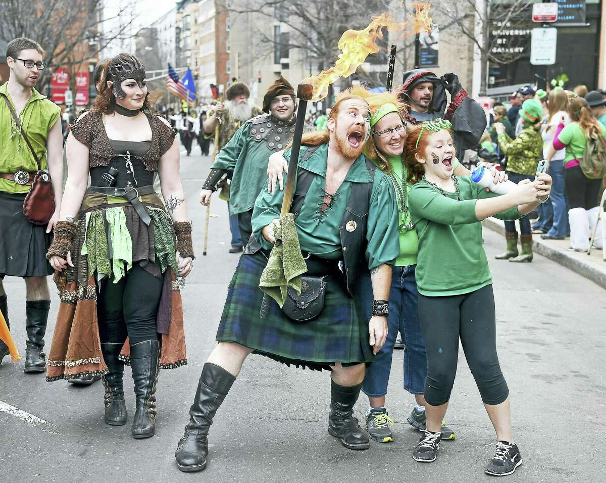 (Arnold Gold-New Haven Register) Daniel Greenwolf (center), general manager of the Midsummer Fantasy Renaissance Faire, poses for a selfie at the New Haven parade.