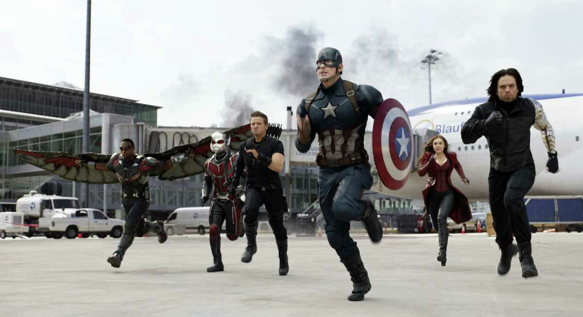 """In this image released by Disney, Anthony Mackie, from left, Paul Rudd, Jeremy Renner, Chris Evans, Elizabeth Olsen and Sebastian Stan appear in a scene from """"Captain America: Civil War."""""""