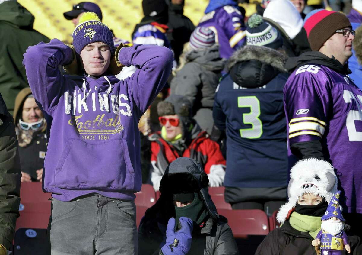 Vikings fans react after Sunday's loss to the Seahawks in Minneapolis.