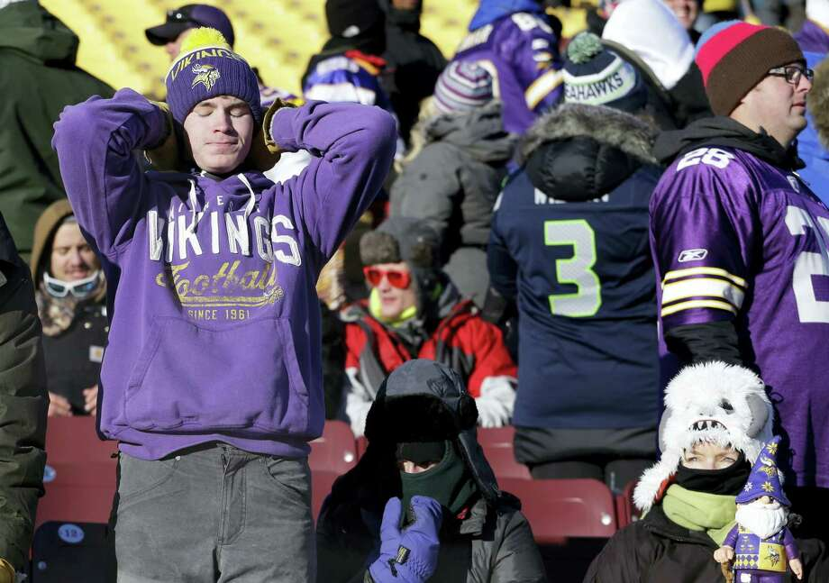 Vikings fans react after Sunday's loss to the Seahawks in Minneapolis. Photo: Nam Y. Huh — The Associated Press  / AP