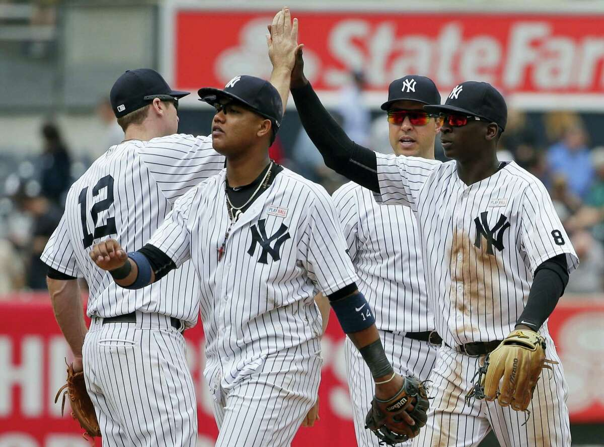 Members of the Yankees celebrate their win over the White Sox on Saturday at Yankee Stadium.