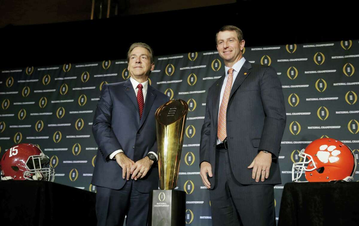 Clemson head coach Dabo Swinney and Alabama head coach Nick Saban pose for a picture during a news conference Sunday in Glendale, Ariz.