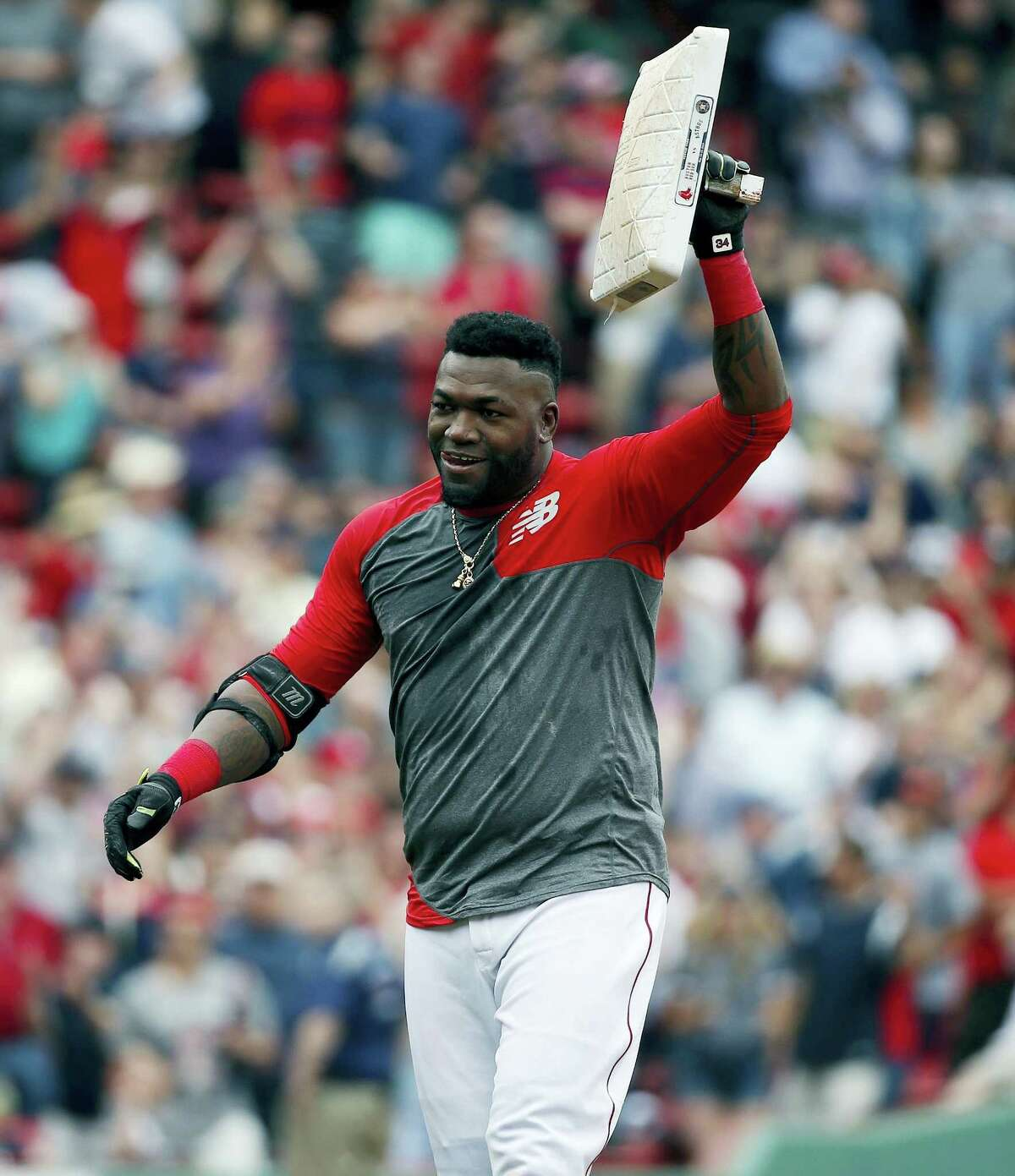 David Ortiz holds up second base after hitting his game-winning RBI double. It was the 600th double of Ortiz's career.