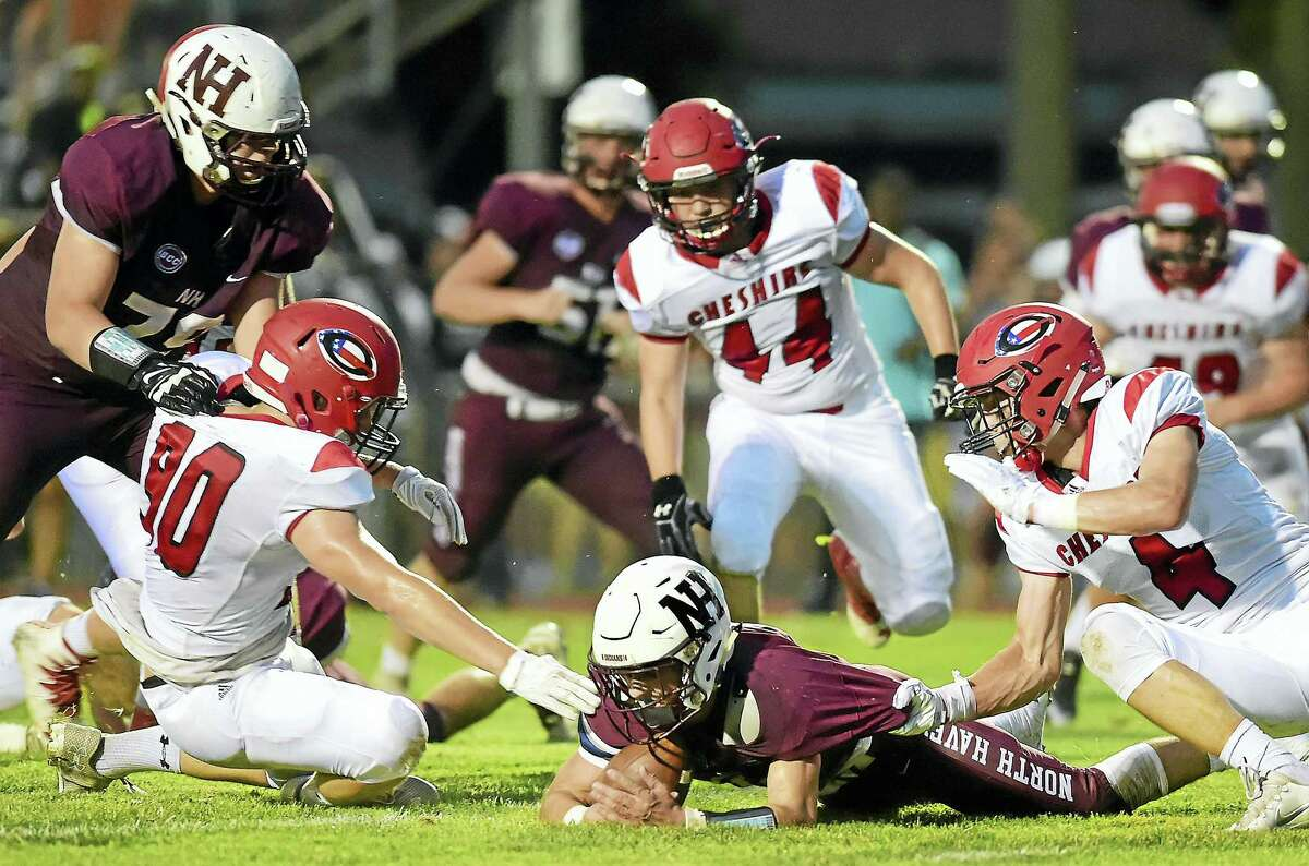 North Haven senior Tom Dodge recovers his fumble losing to Cheshire, 24-21, on opening night of high school football, Friday, September 9, 2016, at Mike Vanacore Field at the North Haven Athletic Complex. (Catherine Avalone/New Haven Register)
