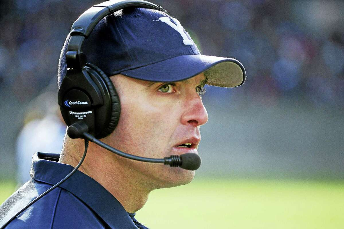 Yale head coach Tony Reno watches his team during the first half of an NCAA college football game against Harvard at Harvard Stadium Saturday, Nov. 22, 2014 in Cambridge, Mass. Harvard defeated Yale 31-24 to remain undefeated and win the Ivy League Championship. (AP Photo/Stephan Savoia)