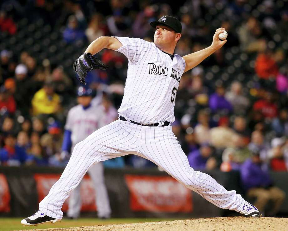 Rockies relief pitcher Jake McGee throws against the Mets during the ninth inning on Saturday in Denver. Photo: Jack Dempsey — The Associated Press  / FR42408 AP