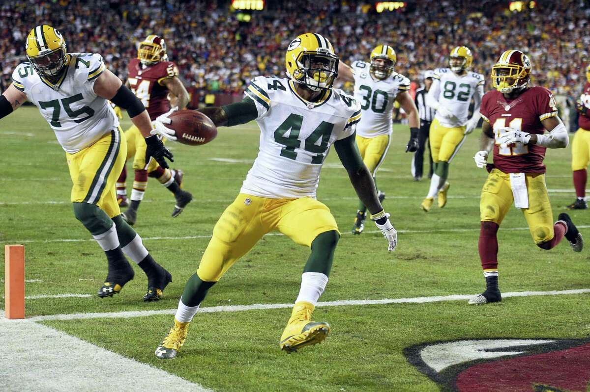Packers running back James Starks scores a touchdown during against Washington on Sunday.