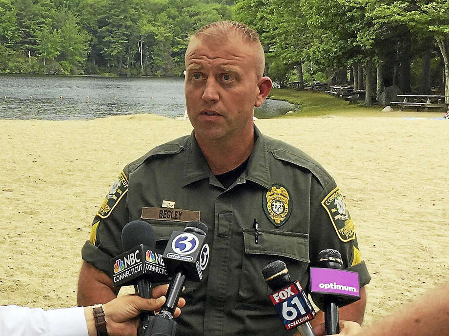 Sgt. Tate Begley of the Connecticut EnCon police gave a press conference Thursday about a purportedly unfounded 911 call made at Burr Pond. Photo: Ben Lambert — The Register Citizen