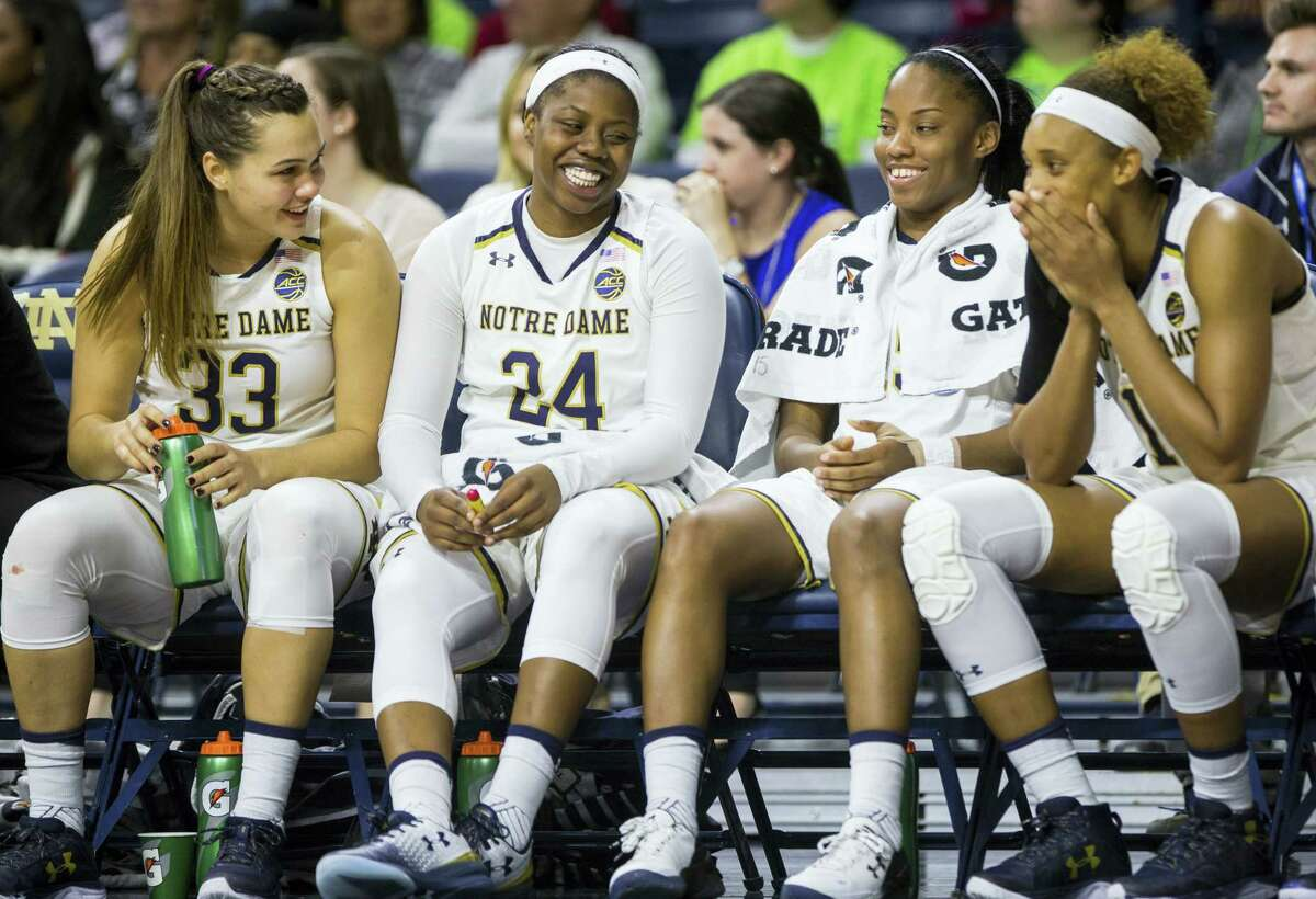 Notre Dame's Kathryn Westbeld (33), Arike Ogunbowale (24), Lindsay Allen, second from right, and Brianna Turner, right, joke around on the bench during the second half of an NCAA college basketball game against Central Michigan on Nov. 11, 2016 in South Bend, Ind.