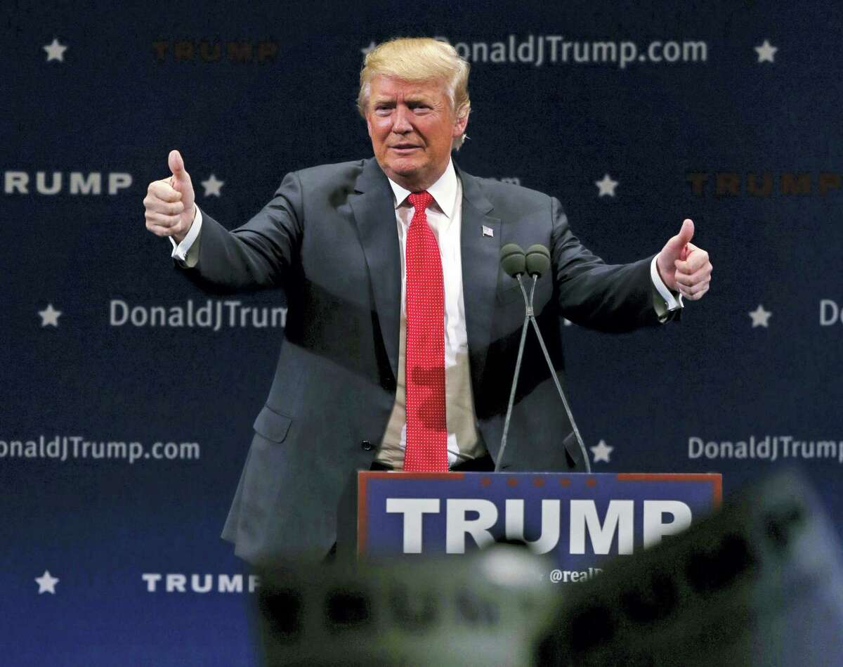 Republican presidential candidate Donald Trump flashes thumbs up after an address to a group of supporters at a campaign stop at the Flynn Center of the Performing Arts in Burlington, Vt. on Jan. 7, 2016.