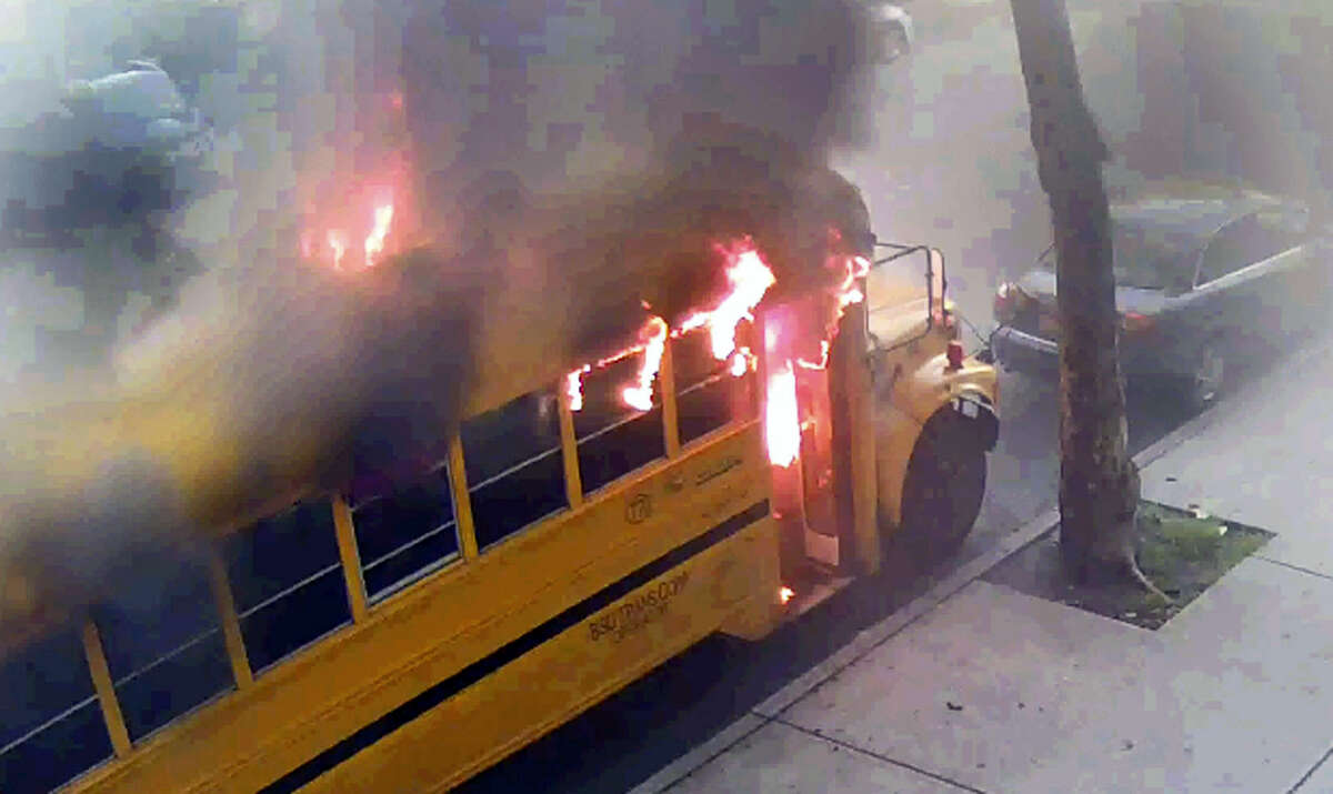 In this frame grab taken from surveillance video, a school bus burns after it was set on fire by children Sunday, May 8, 2016, in the Crown Heights section of the Brooklyn borough of New York. When the group of young, black children set fire to the school bus outside a Jewish school, it evoked bad memories of a violent riot in the same Brooklyn neighborhood 25 years ago. Relations between blacks and Jews in Crown Heights have been peaceful for many years, but some community leaders say tensions remain.