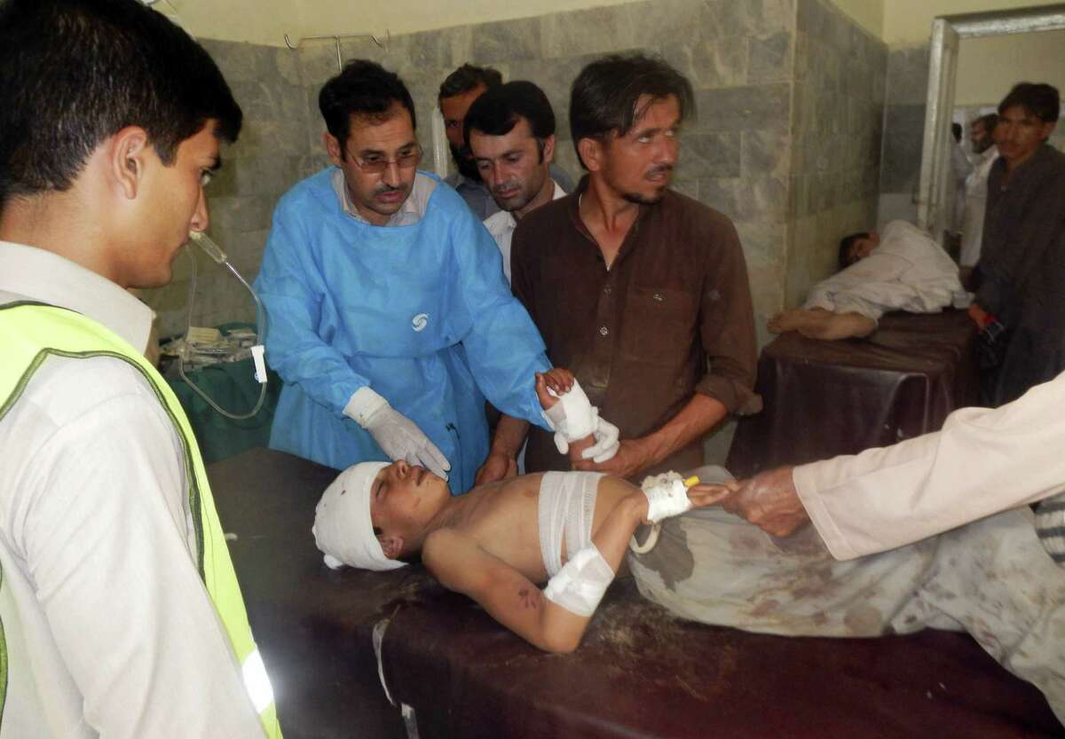 A Pakistani child who was injured in a suicide bombing is treated at a local hospital in Khar, Pakistan, Friday, Sept. 16, 2016. A suicide bomber attacked a Sunni mosque in northwest Pakistan on Friday, killing dozens of worshippers and wounding many others, officials said. Several children were also among those killed or wounded in the deadly attack.