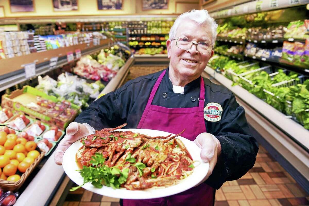 Giuseppe Fappiano, executive chef at Ferraro's Market, shows off spaghetti with crab sauce.