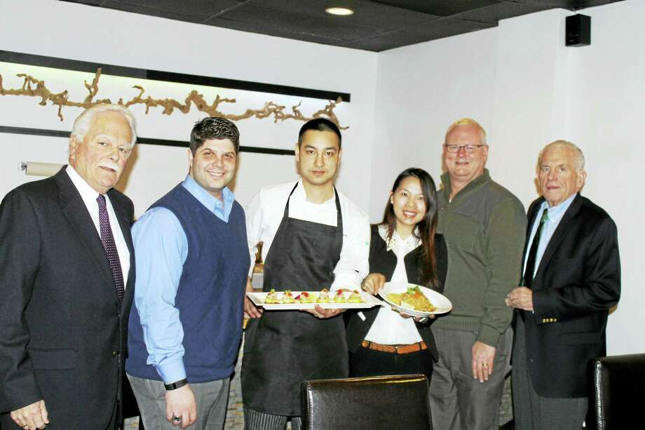 Hachi, a new Japanese restaurant at 320 Main St., Middletown, held its grand opening recently. From left  are Middletown Small Business Development Center Counselor Paul Dodge, Mayor Dan Drew, chef/owner Yin Lin (Leo), manager Maggie Huang, Chamber Central Business Bureau Chairman Tom Byrne, and Chamber President Larry McHugh. Photo: Courtesy Photo