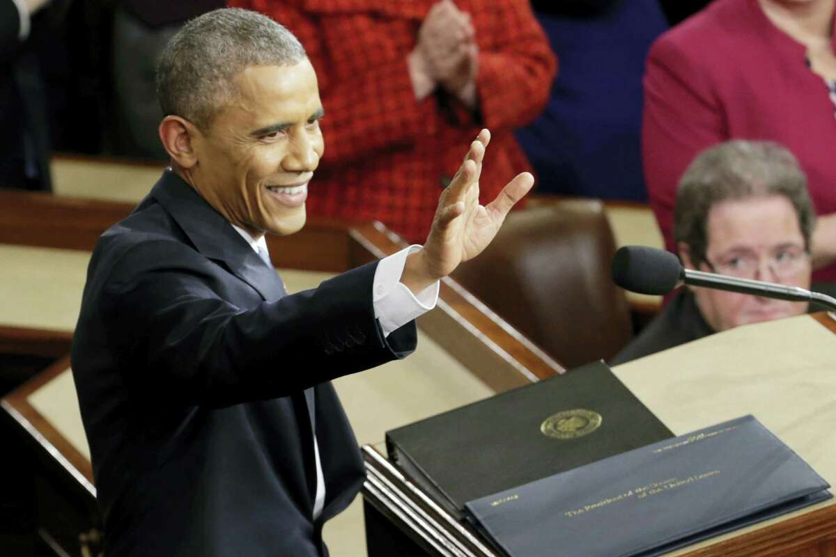 In this Jan. 20, 2015 photo, President Barack Obama waves before giving his State of the Union address before a joint session of Congress on Capitol Hill in Washington. Obama will deliver his final State of the Union address Tuesday, Jan. 12, 2016 to a nation with a burgeoning job market, flat wages and two things that to the president's dismay are rising: global temperatures and Americans' concerns about terrorism.