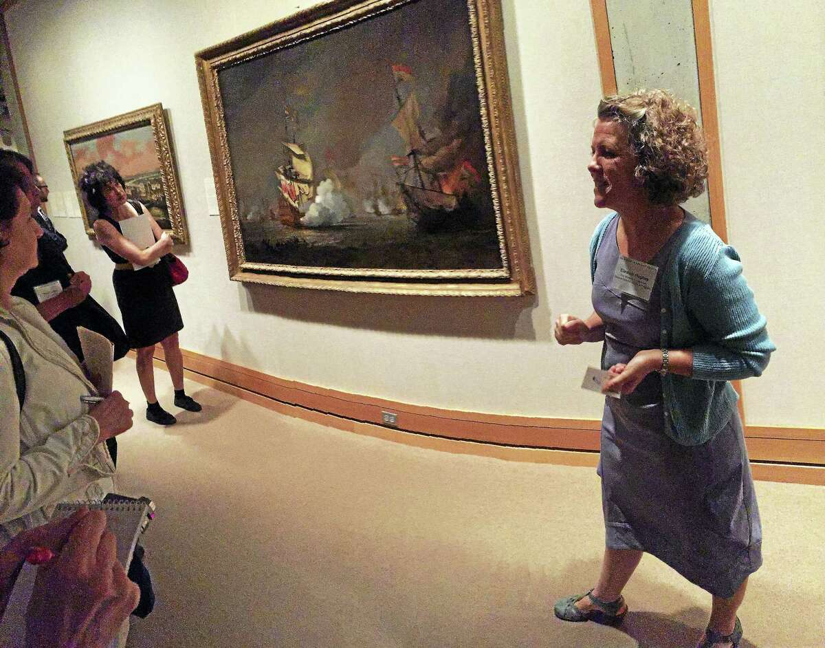 """Curator Eleanor Hughes, right, with Willem van de Velde the Younger's """"Sea Battle of the Anglo-Dutch Wars."""""""