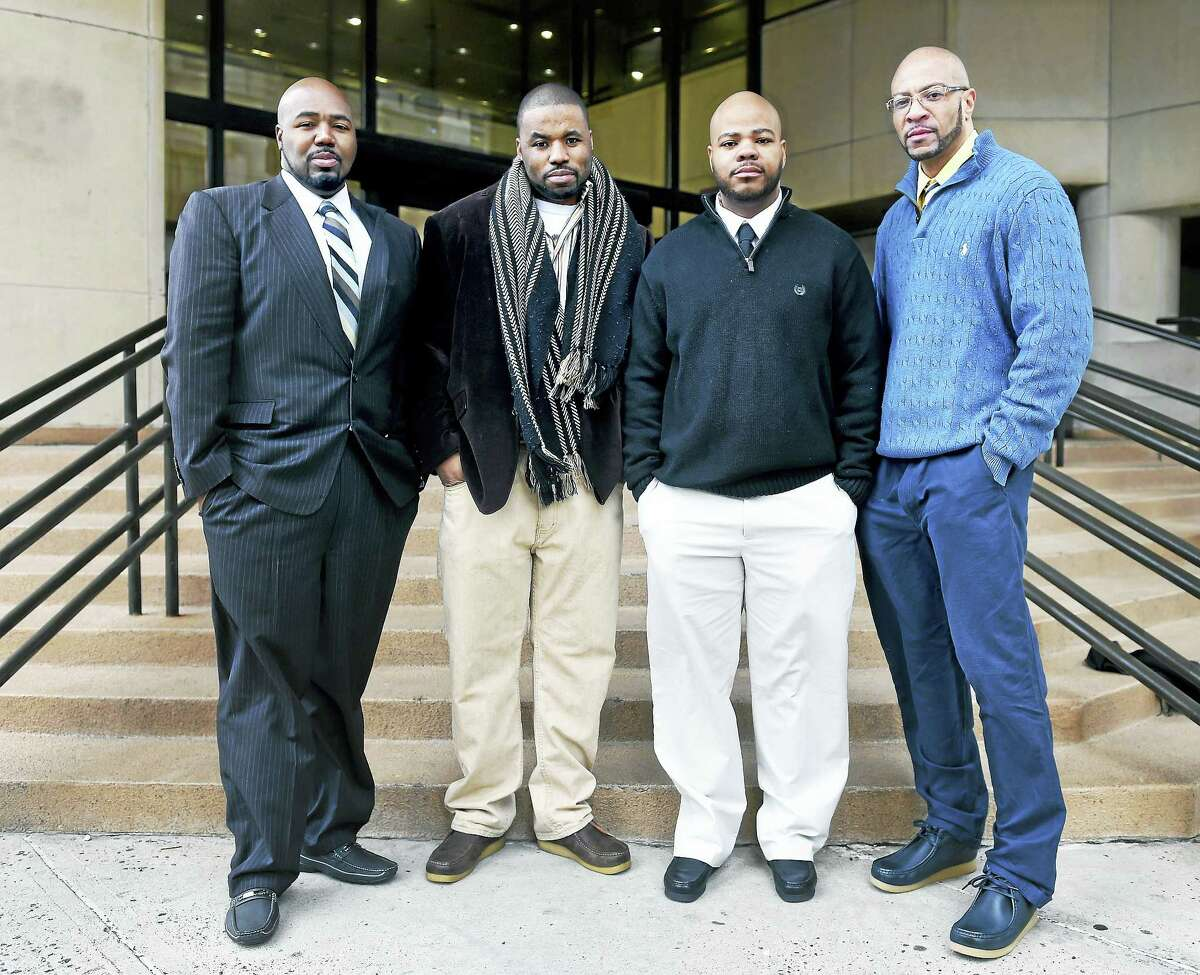 ARNOLD GOLD — NEW HAVEN REGISTER Left to right, Darcus Henry, Carlos Ashe, Johnny Johnson and Sean Adams are photographed last week in front of Superior Court in New Haven. The four were released from prison after serving 17 years for a murder in 1996 for which they were wrongfully convicted.