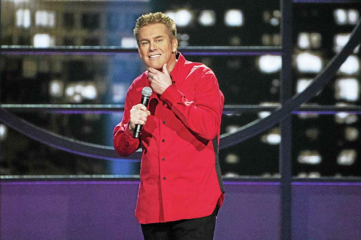 Brian Regan performs on stage.