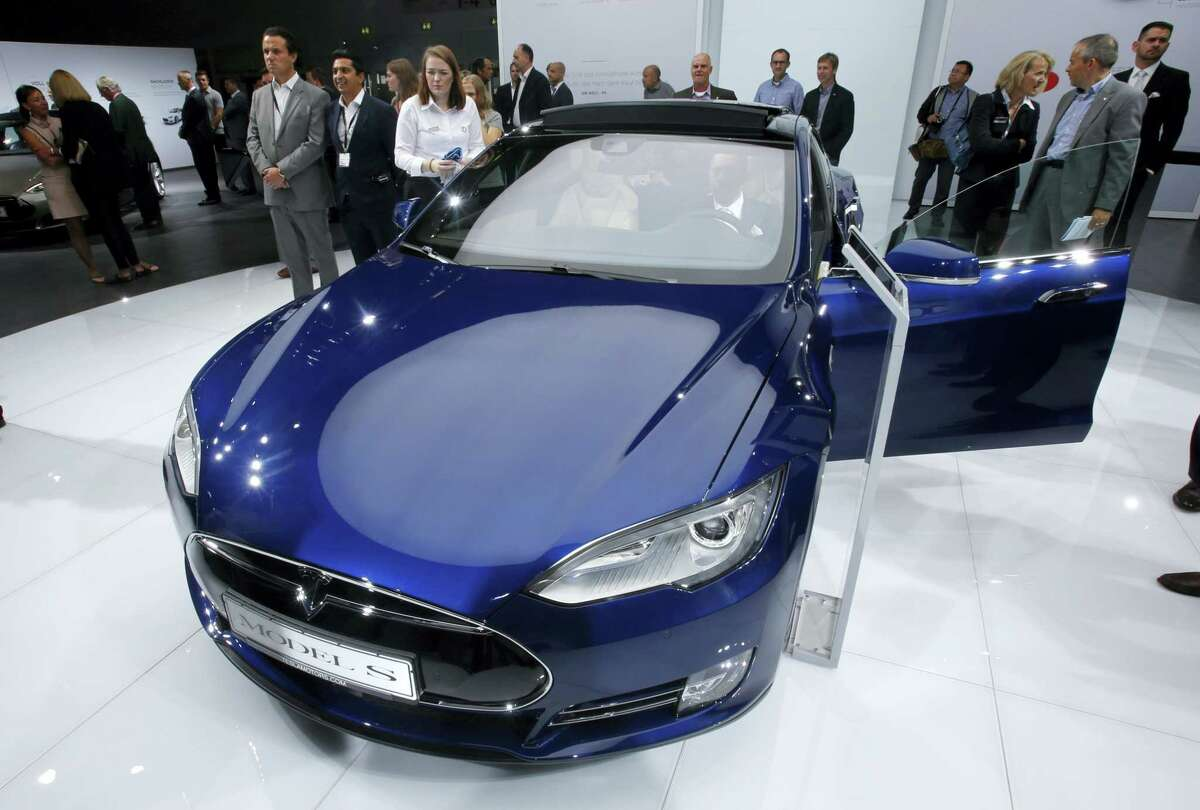 In this Sept. 15, 2015, photo, a Tesla Model S is on display on the first press day of the Frankfurt Auto Show IAA in Frankfurt, Germany.
