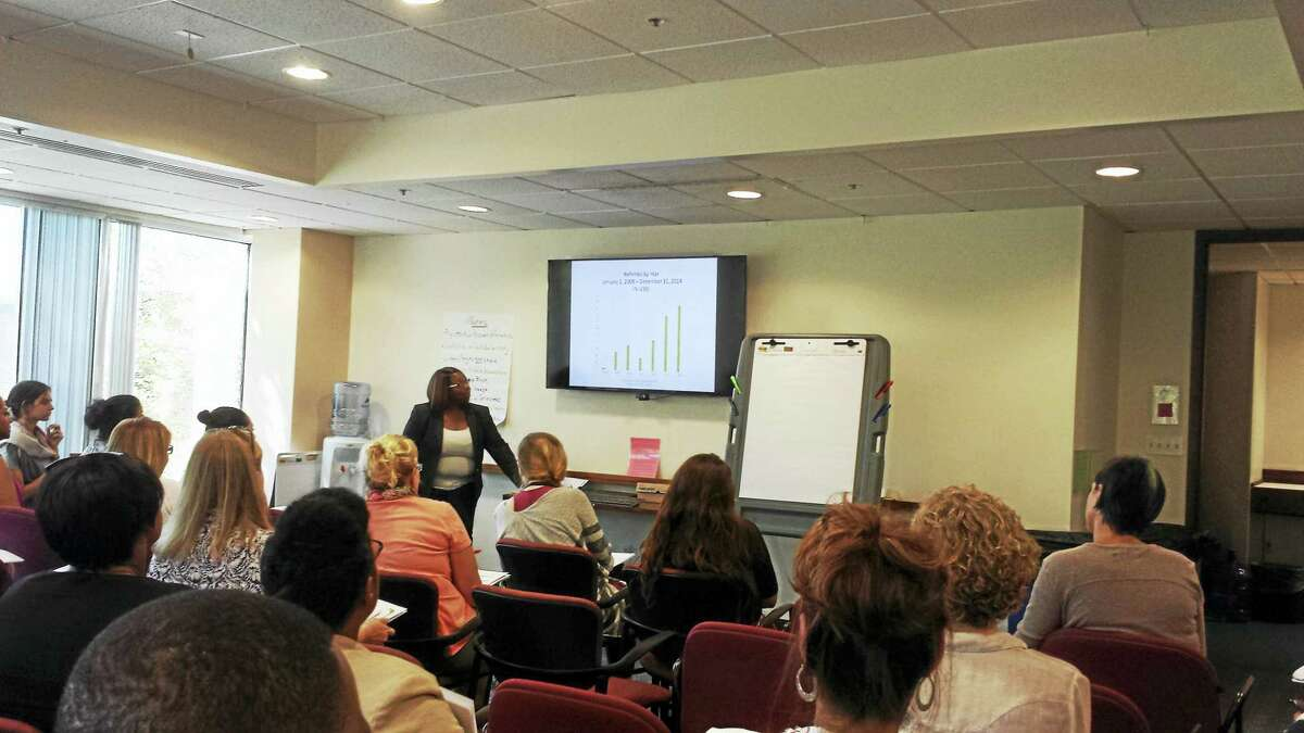 Latoya Lowery of the state Department of Children and Families speaks about human trafficking of youths Wednesday in Hamden.