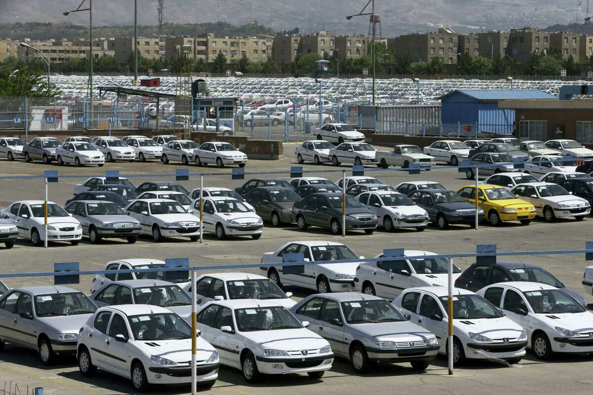 Cars are parked in a depot at the state-run Iran Khodro automobile manufacturing plant, just outside Tehran, Iran.