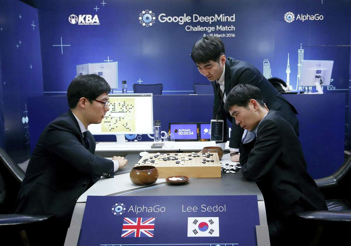 South Korean professional Go player Lee Sedol, right sit, reviews the match with other professional Go players after winning the fourth match of the Google DeepMind Challenge Match against Google's artificial intelligence program, AlphaGo, in Seoul, South Korea on March 13, 2016. The champion Go player scored his first win over Go-playing computer software on Sunday after losing three straight times in the ancient Chinese game.