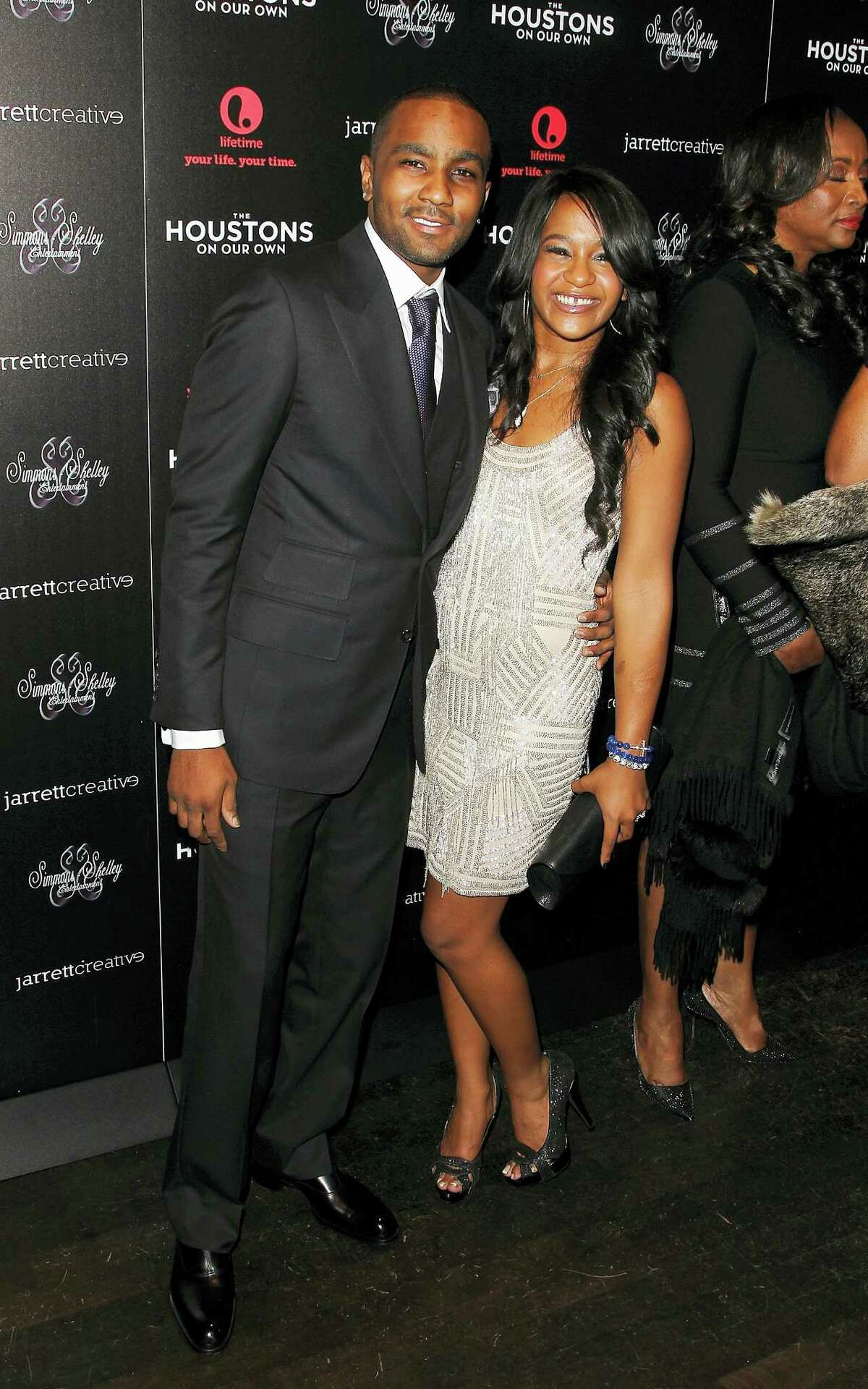 """This Oct. 12, 2012, file photo shows Nick Gordon and Bobbi Kristina Brown attending the premiere party for """"The Houstons On Our Own"""" at the Tribeca Grand hotel in New York. A judge in Atlanta on Friday, Sept. 16, 2016, ruled against Gordon, in a wrongful death lawsuit filed by her estate. Fulton County Superior Court Judge T. Jackson Bedford signed an order saying Gordon repeatedly failed to meet court deadlines in the case and, therefore, the conservator of her estate wins by default."""