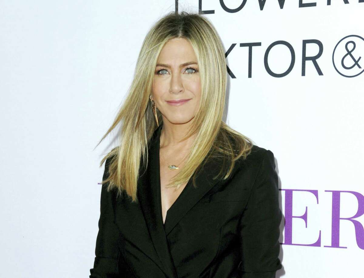 """In this April 13, 2016, file photo, Jennifer Aniston arrives at the Los Angeles premiere of """"Mother's Day."""" Aniston says she's not pregnant and she's fed up with predatory tabloid culture that defines women by their looks and maternal status."""