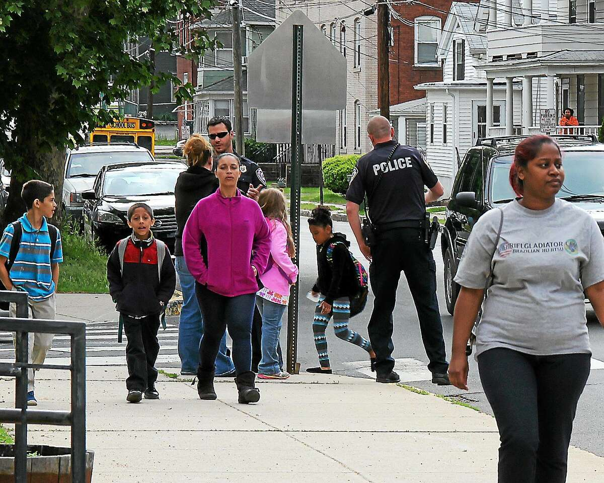 Middletown police assist parents and students at the high traffic crosswalk on Thursday in front of Macdonough Elementary School.