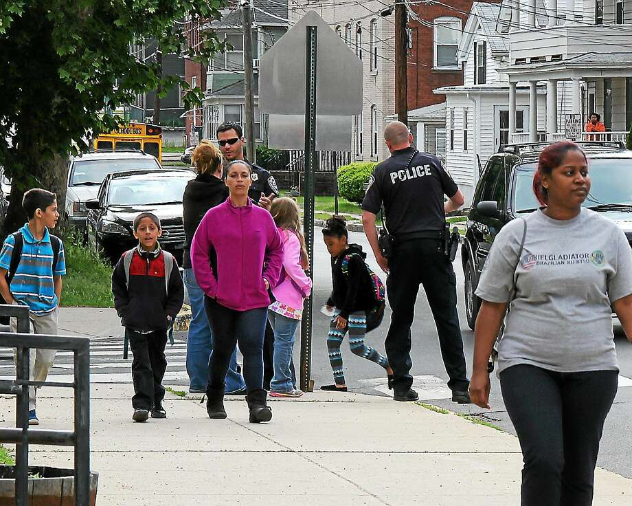 Middletown police assist parents and students at the high traffic crosswalk on Thursday in front of Macdonough Elementary School. Photo: File Photo  / Kathleen Schassler All Rights