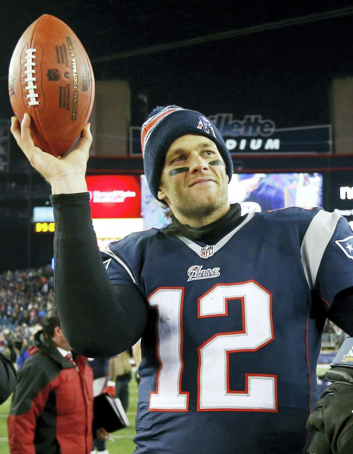 In this Jan. 10, 2015, file photo, New England Patriots quarterback Tom Brady holds up the game ball after an NFL divisional playoff football game against the Baltimore Ravens in Foxborough, Mass. On Wednesday, July 13, 2016, a federal appeals court has rejected Tom Brady's attempt to get a new hearing on his suspension. Brady was asking for the full 2nd U.S. Circuit Court of Appeals to hear the case. In April, a three-judge panel said that NFL commissioner Roger Goodell was within his powers when he suspended the star quarterback four games for his role in a scheme to doctor the footballs used in a Jan. 18, 2015, playoff game. (