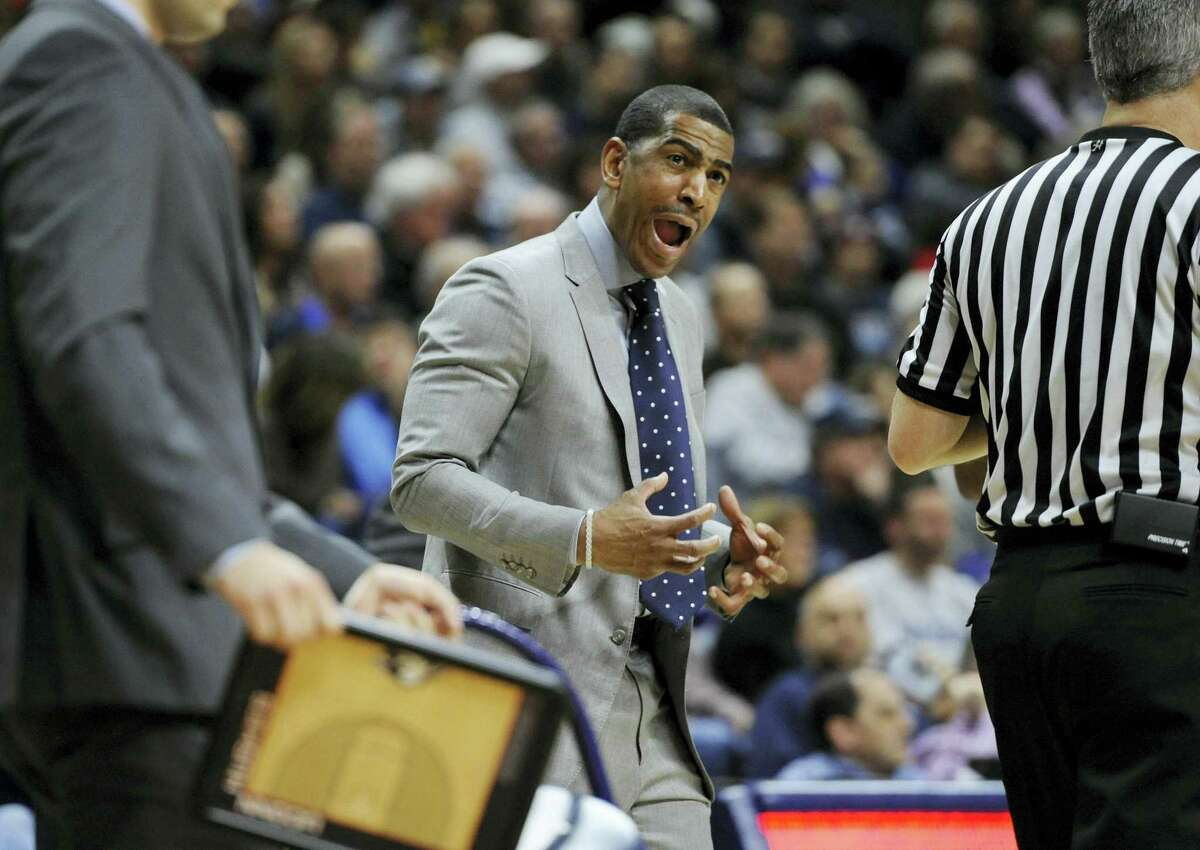 UConn head coach Kevin Ollie reacts in the first half of Saturday's game against Memphis.