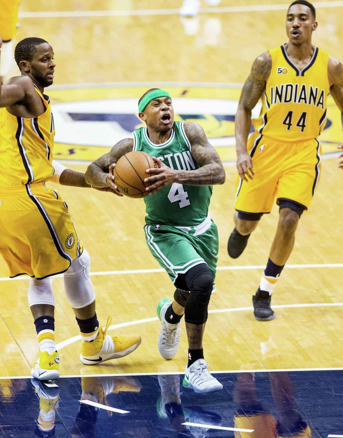 Boston Celtics guard Isaiah Thomas (4) drives the ball to the basket in the second half of an NBA basketball game, Saturday, Nov. 12, 2016, in Indianapolis. The Celtics won 105-99. (AP Photo/Doug McSchooler)