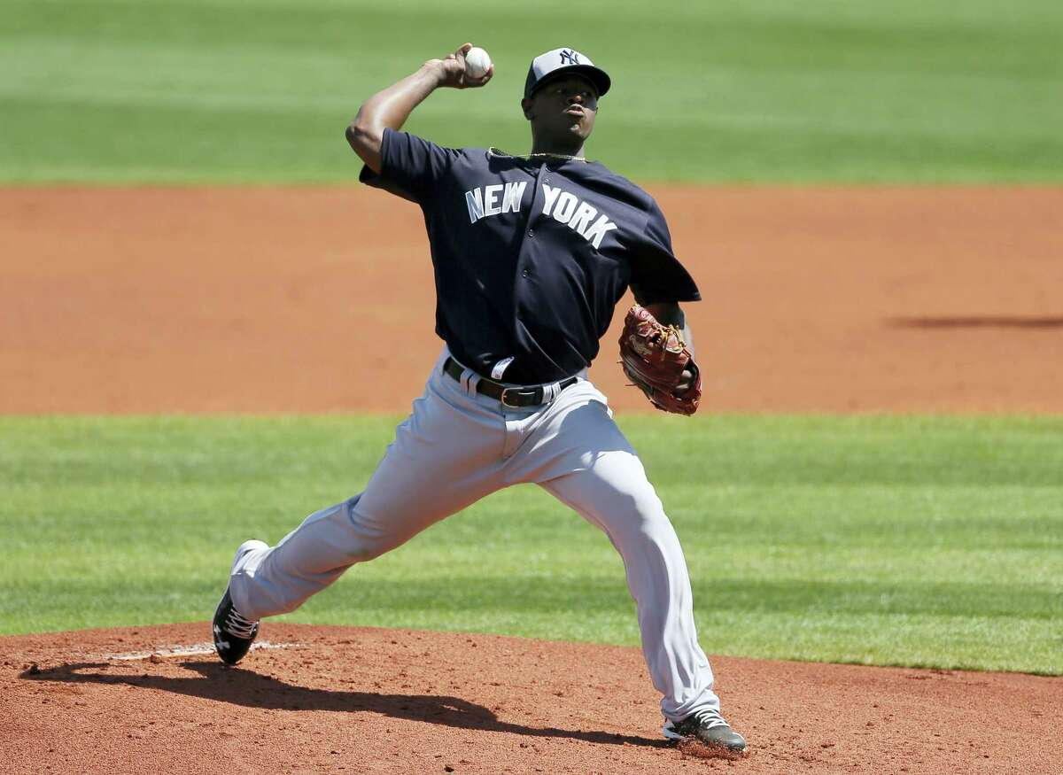 Yankees starting pitcher Luis Severino works against the Rays in the first inning on Saturday.
