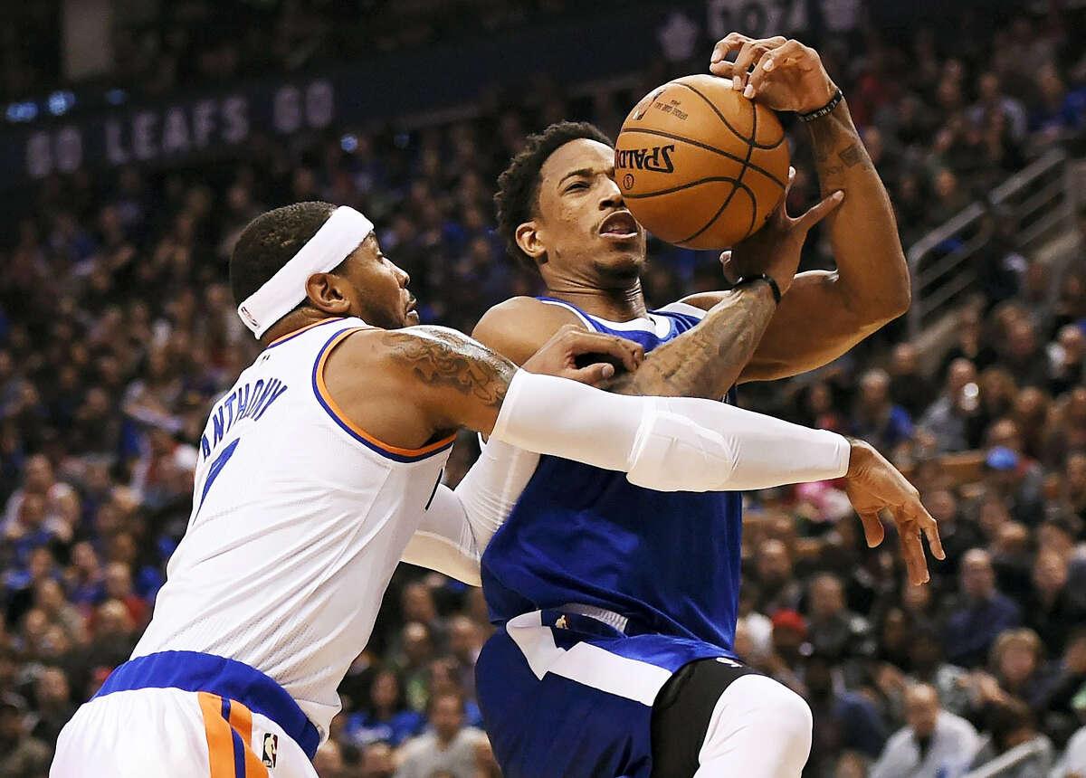 Toronto Raptors guard DeMar DeRozan (10) drives against New York Knicks forward Carmelo Anthony (7) during the first half NBA basketball game in Toronto on Saturday, Nov. 12, 2016. (Nathan Denette/The Canadian Press via AP)