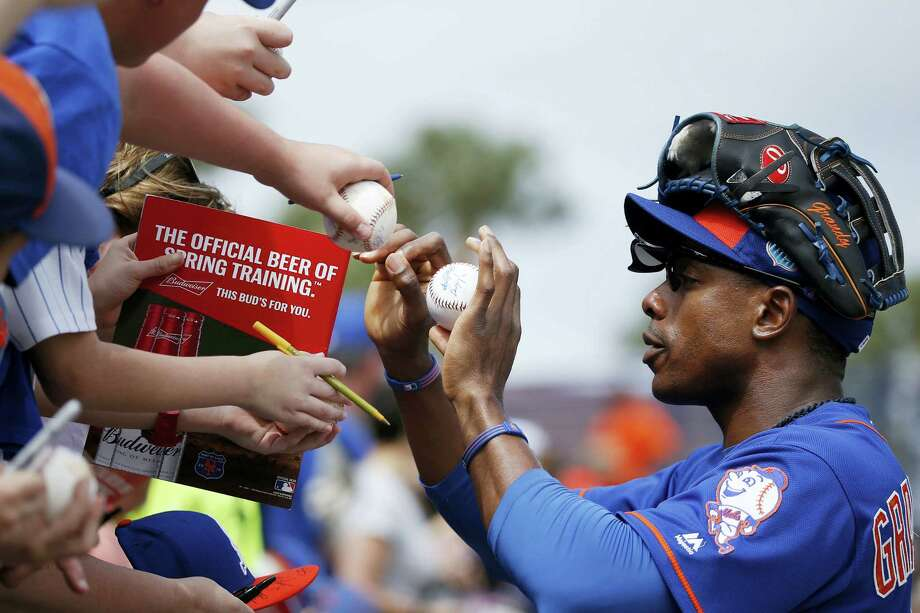 Mets' right fielder Curtis Granderson sign autographs before an Saturday's exhibition game against the Cardinals. Photo: Brynn Anderson — The Associated Press  / Copyright 2016 The Associated Press. All rights reserved. This material may not be published, broadcast, rewritten or redistributed without permission.