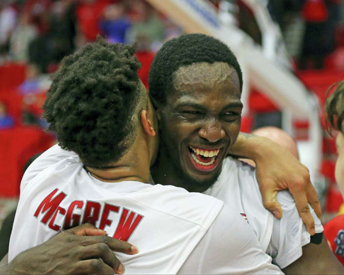 Stony Brook's Rayshaun McGrew, left, and Jameel Warney celebrate following their 80-74 win over Vermont in the championship of the American East Conference tournament on Saturday.