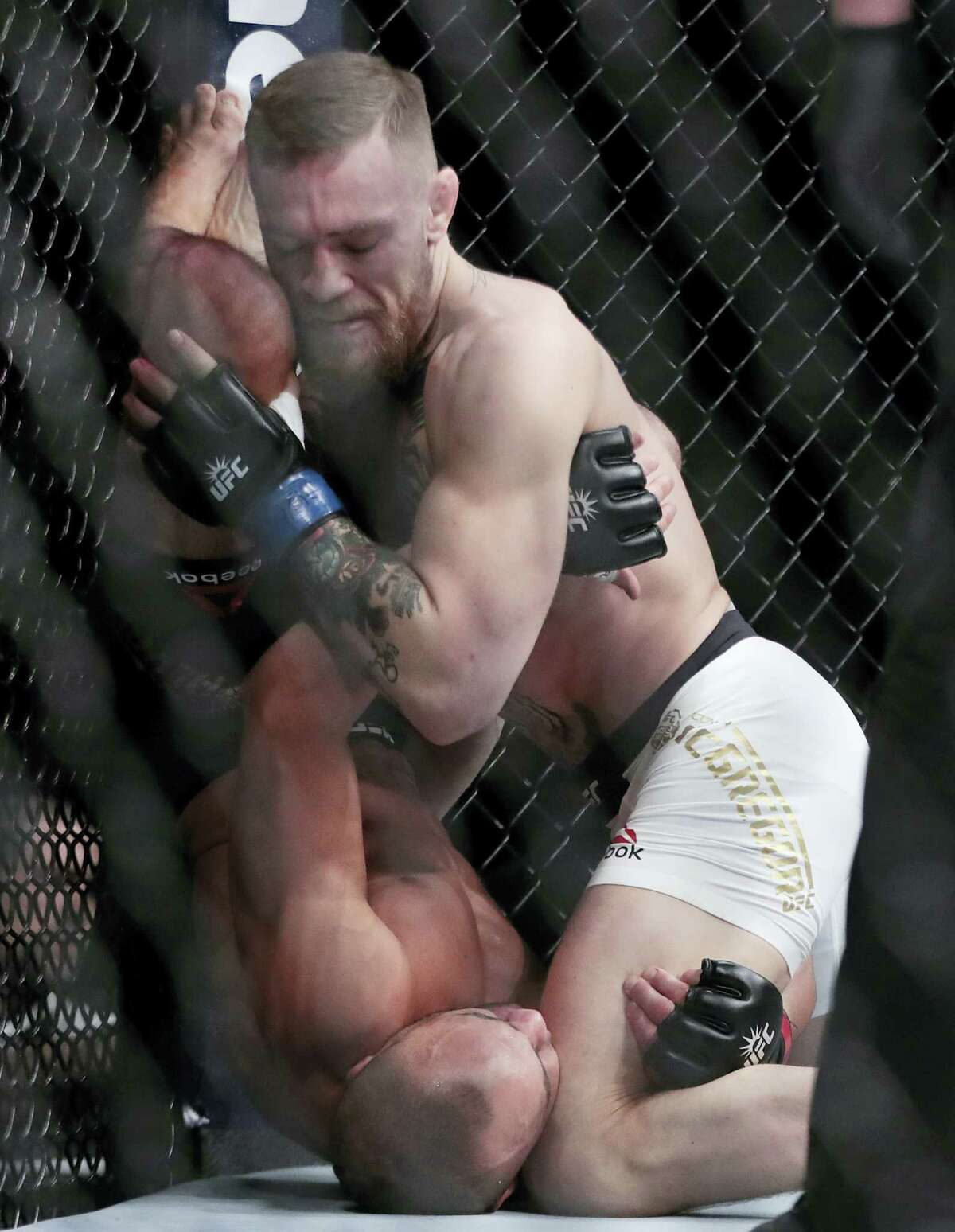Conor McGregor, right, fights Eddie Alvarez during a lightweight title mixed martial arts bout at UFC 205 early Sunday, Nov. 13, 2016 at Madison Square Garden in New York.
