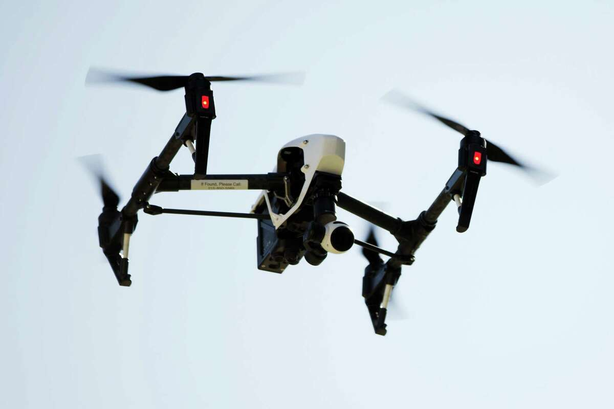 In this file photo, a drone captures videos and still images of an apartment building in Philadelphia.