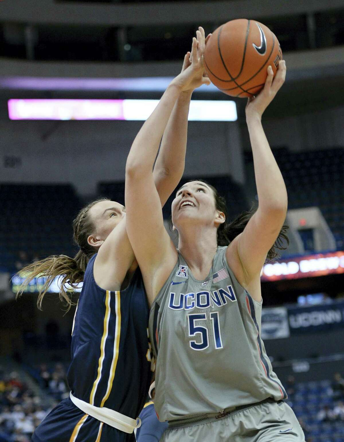 Connecticut's Natalie Butler shoots as Pace's Kirsten Dodge, left, defends in the second half of a preseason NCAA college basketball game, Sunday, Nov. 6, 2016, in Hartford, Conn. (AP Photo/Jessica Hill)
