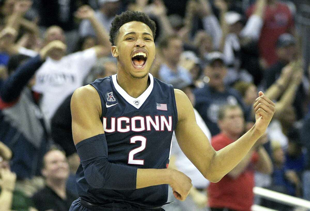 UConn guard Jalen Adams celebrates after a score during the second half of Saturday's AAC semifinal game against Temple in Orlando, Fla.
