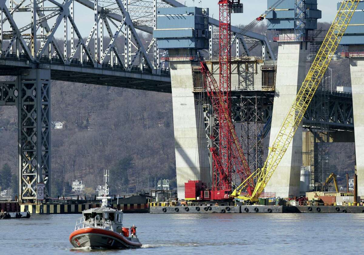A Coast Guard boat passes near the site of a fatal collision in the water underneath the Tappan Zee Bridge in Tarrytown, N.Y., Saturday, March 12, 2016. A tugboat crashed into a barge on the Hudson River north of New York City early Saturday killing at least one crew member and leaving two still missing.