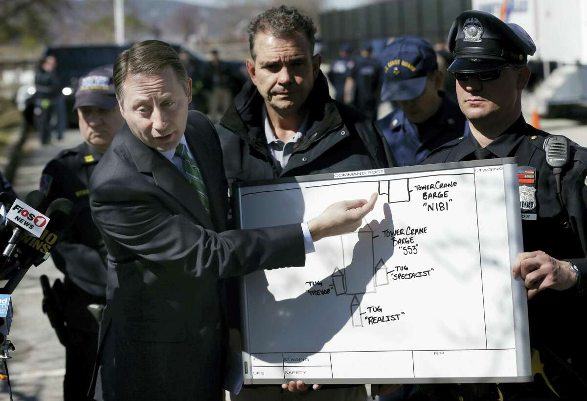Westchester County Executive Rob Astorino, left, uses a diagram to explain the circumstances of a fatal collision on the water in Tarrytown, N.Y., Saturday, March 12, 2016. A tugboat crashed into a barge on the Hudson River north of New York City early Saturday killing at least one crew member and leaving two still missing.