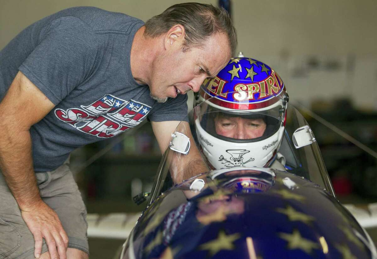 Rocket designer Scott Truax, left, talks with professional stuntman Eddie Braun at the team's shop in Twin Falls, Idaho. Braun is preparing to attempt to jump the Snake River Canyon in a steam-powered replica of Evel Knievel's rocket.