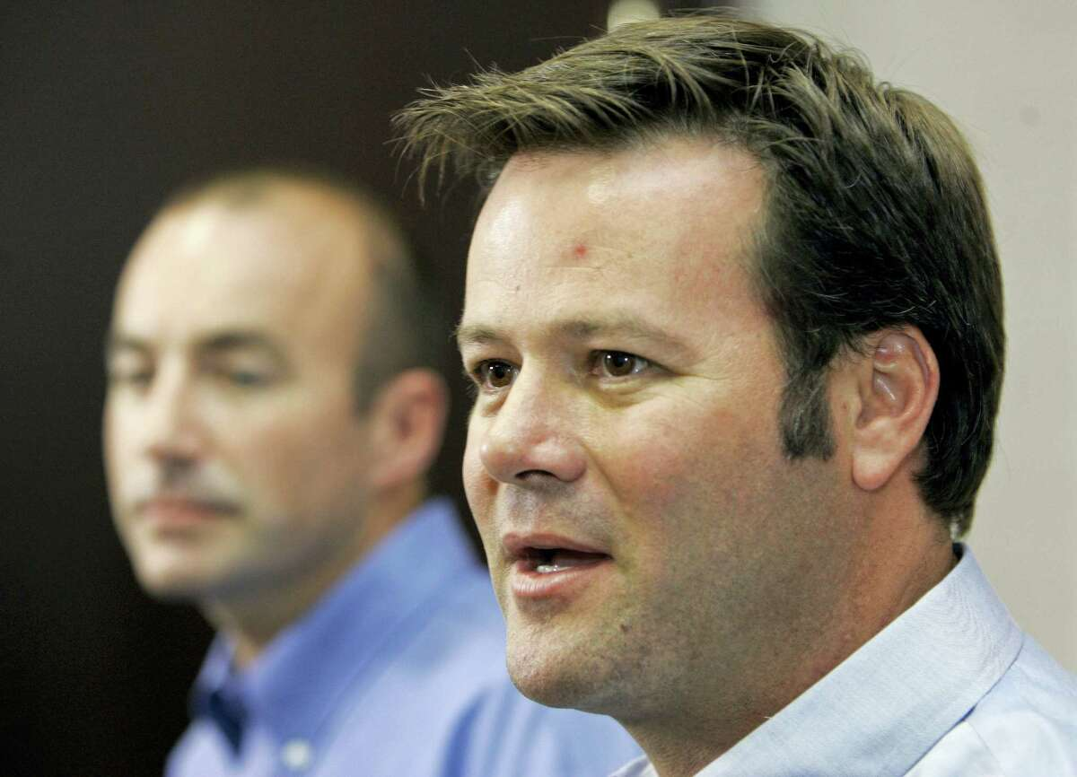 In this file photo, NASCAR racer Robby Gordon, right, answers a question during a news conference in Charlotte, N.C. Police said a husband and wife were found dead inside a home Wednesday in Orange and a neighbor said they were Gordon's father and stepmother.