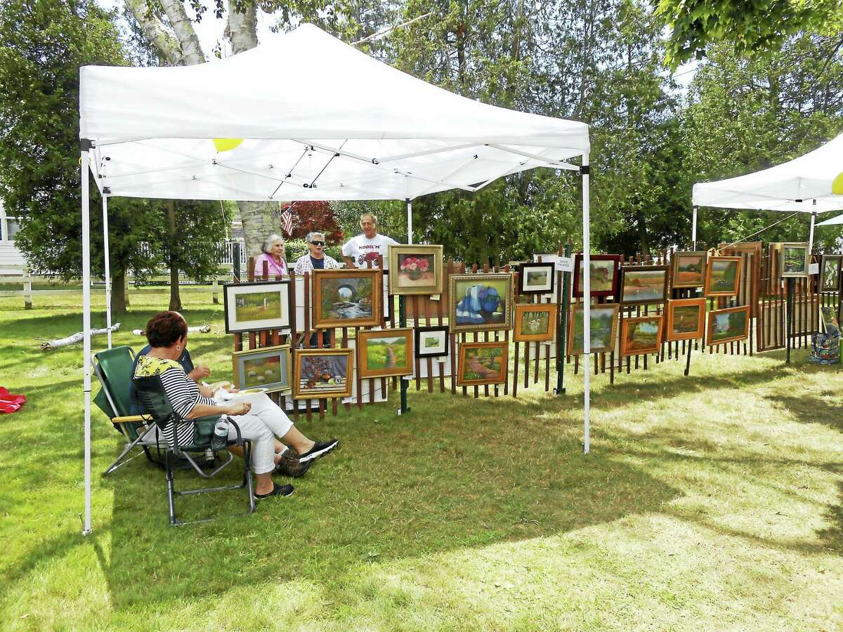 Contributed photos The Plein Air Painters Fence Show, of Old Lyme will hold the yearly Outdoor Show on Saturday, July 30, 9 a.m.-4 p.m. on the front lawn of Center School