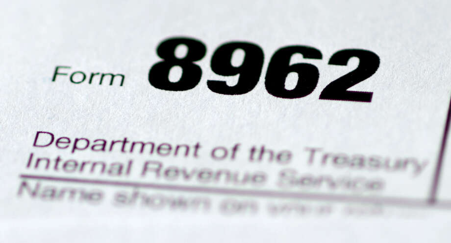 Health care tax form 8962 is seen in Washington. Photo: Carolyn Kaster — The Associated Press  / AP