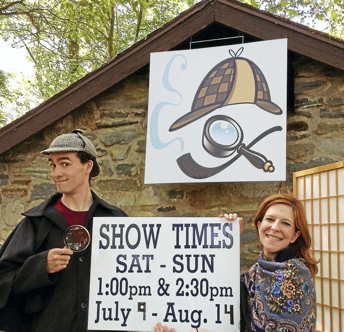 """Photo by Kandie Carle East Haddam Stage Company members Alex Kirstukas of Avon plays the roles of William Gillette / Sherlock Holmes, while Nicole Morin of New Haven performs """"everyone else"""" at Gillette Castle State Park."""