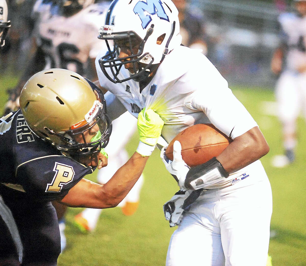 Platt's Tylon Papallo tries to slow down Middletown senior quarterback Tyshaun James in the Blue Dragons' 49-24 win last week. Middletown hosts Wethersfield tonight at Rosek-Skubel Stadium.