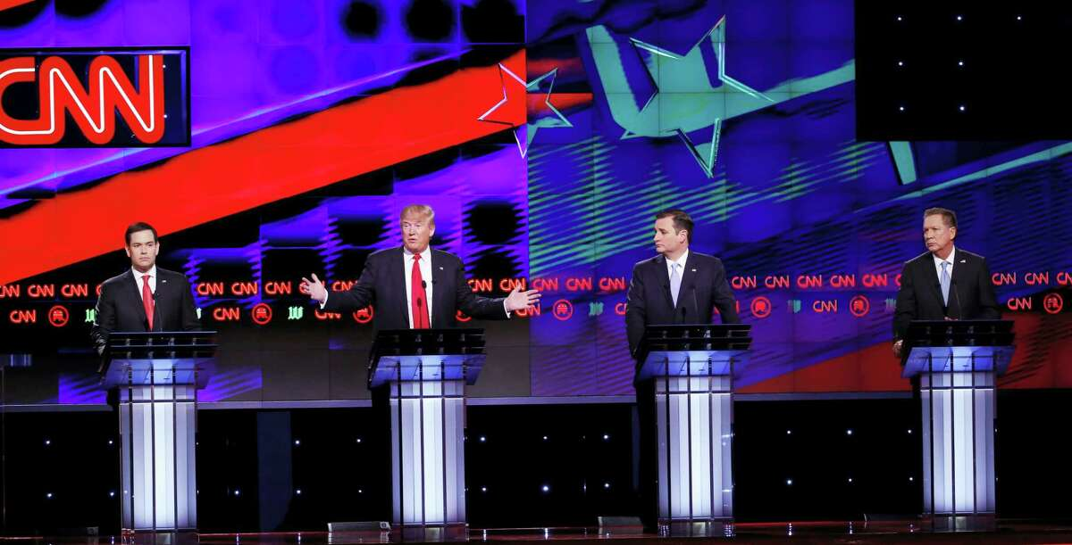 Republican presidential candidate, businessman Donald Trump, speaks, as Republican presidential candidates, Sen. Marco Rubio, R-Fla., , Sen. Ted Cruz, R-Texas, and Ohio Gov. John Kasich, listen, during the Republican presidential debate sponsored by CNN, Salem Media Group and the Washington Times at the University of Miami, Thursday, March 10, 2016, in Coral Gables, Fla.
